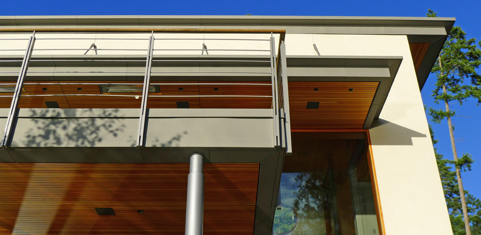 <p>Secret Cove House - Sunshine Coast - West Deck</p><p>2,500 sq ft part-time home, to be completed in 2012.</p><p>The house is located on the North side of a narrow ravine with a view of Georgia Straight to the West. Boat access to the house from below will be used as much as the road access at the upper level. The Upper Floor is organized into two distinct wings of Living, Dining, Kitchen and Master Bedroom & Bath, with a central skylit Breezeway between. The generous West Deck is continuous with the East Entry Terrace through the Breezeway which feels like an indoor/outdoor space. The pivotal breezeway also connects the Upper Floor to the Lower Floor Den, Bedrooms and Bathrooms, with a stair directly between the Upper and Lower Floor Entrances. The palette of construction materials was limited to limestone plaster, stone, Douglas fir, and zinc, with conventional wood framing. The main walls of the house are given a monolithic quality with the use of a smooth plaster that continues from inside to outside. Basaltina stone flooring throughout is continuous with the same material on the terraces. All ceilings and soffits are in slatted Douglas fir, including the wave-form ceilings of the Upper Floor wings.The window frames and sliding doors are also made of fir. This warm wood interior is further enhanced with generous fir panelling and built-in cabinetry.</p>