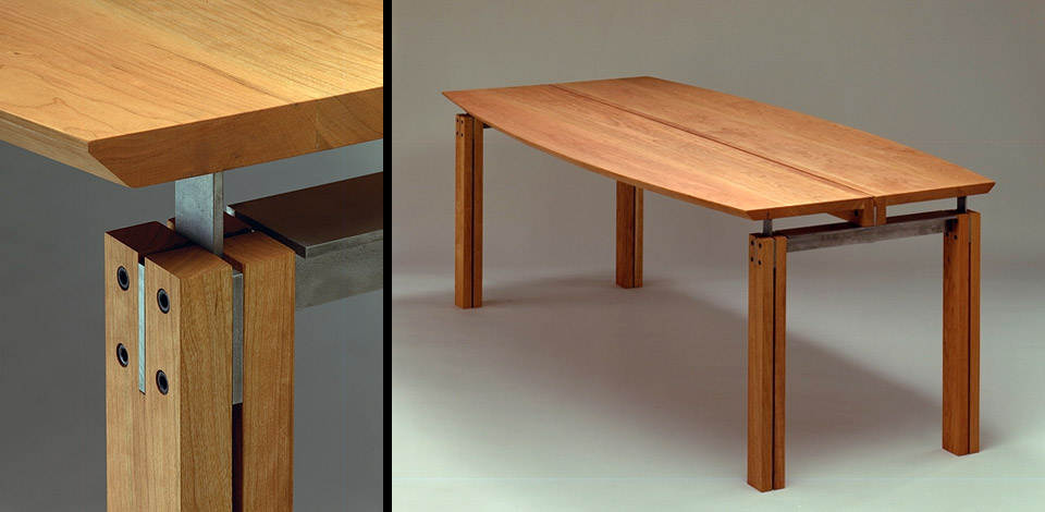 <p>Axis Table</p><p>1992</p><p>Designed as a multi-purpose table for dining rooms or boardrooms. Originally retailed by Living Space in Vancouver. Custom made in many lengths and materials including solid cherry, maple and walnut. In 1999 two 9' long cherry boardroom tables were made for the Canadian Airlines First Class Lounge at the Vancouver International Airport.</p><p>Shown here in solid cherry with cold rolled steel brackets.</p><p>Height 28'' Width 40'' Length 7'-0''</p>