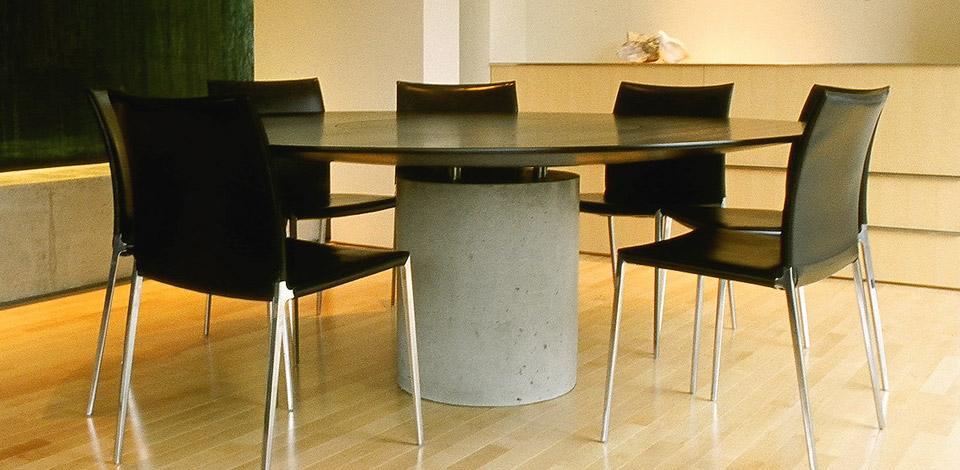 <p>Lense Table</p><p>2004</p><p>Cutom designed as a Dining Table for a residence designed by Bing Thom.</p><p>The top is solid hardwood, stained, supported by a cast concrete base, with stainless steel posts, and a flush rotating centre.</p><p>Height 28'' Diameter 7'-0''</p>